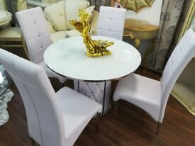 Brand new Glass table with 4 chairs
