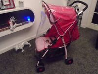 Almost new Hauck lie flat buggy with footmuff & raincover