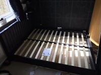 Black Faux Leather King Sizer Bed Frame. Used. Good condition. Needs to be assembled