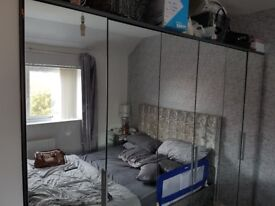 Spotless mirror wardrobes 8ft long 6ft tall only 3 mth old paided £500