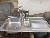 Stainless steel kitchen sink and taps