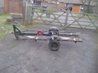 Motor cycle trailer all good but needs one tire got a winch,