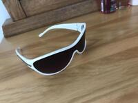 White framed wrap around sunglasses