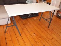 High gloss white desk with trestle legs. Originally from Ikea and in very good condition. £20.
