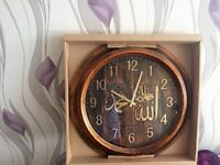 Abig circular clock with arabic writing