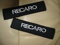 A PAIR OF RECARO LOGO BLACK SEATBELT COVER PADS.