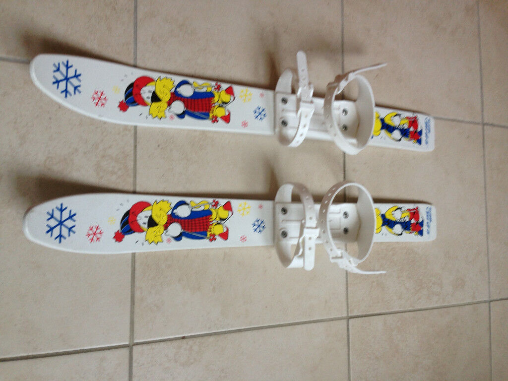 Pair of plastic skis for 2-4 year old