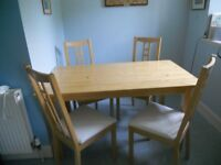 """Kitchen table ( 53""""Lx29""""Hx29""""W)and 4 matching chairs with removable covers for washing."""