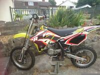 Suzuki RM80 2006 runs great also a selection of body armour helmets boots and a 2 bike trailer