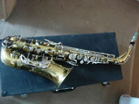 Alto saxophone with mouthpiece, new reeds, sling, case etc- great entry-level sax at a bargain price
