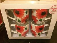 Set of 4 mugs unused in original box & a small red teapot