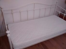 Day bed with lacquered white metal frame, and mattress.