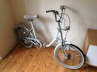 Pre-loved white bicycle