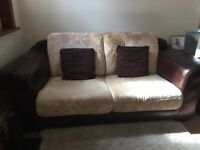 Brown leather frame 2-3 seater fabric sofa. Excellent cushions and life.