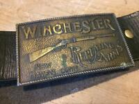 Winchester belt buckle with leather belt attached.