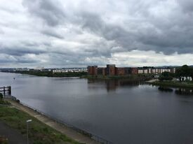 Modern top floor flat with views over the River Clyde ideally suited for professionals and couples
