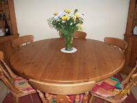 Solid pine round table ( 140 cm dia ) complete with 6 wooden chairs with cushions