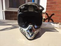 Grey flamed takachi motocross helmet