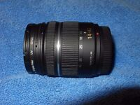 LUMIX G VARIO 14 - 42 f3.5 - 5.6 MEGA OIS ZOOM LENS in very good condition with UV filter.