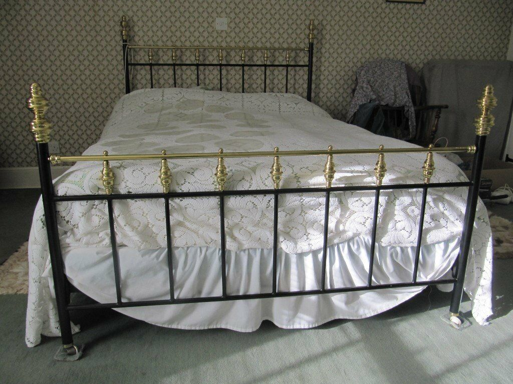 Double brass and black metal bedstead