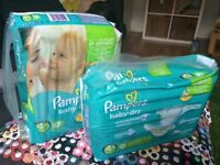 2 large packs of Pampers nappies