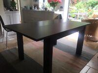 Dining Table - Habitat extendable black wood.