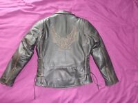 Nearly new leather motor bike jacket size medium with armour