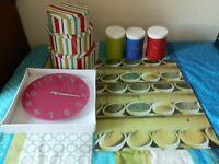 3 Different size cake tins, 2 Heat resistant chopping boards, 1 Clock, Tea, Coffee, Sugar canisters