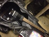 Black Epiphone Gibson Special Model. Second hand. Works Fine. Nice quality solid guitar.