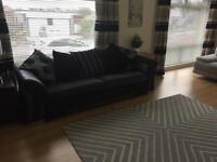 Black and silver grey dfs sofa from smoke free home.