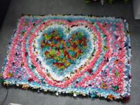 HAND MADE HEART PATTERNED RAG RUG. MADE WITH ALL NEW FABRICS, WOULD MAKE A LOVELY XMAS GIFT.
