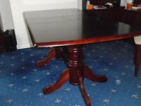 Extendable mahogany table with four chairs