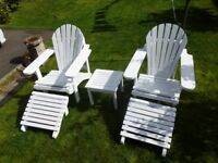 Adirondack garden chairs with ottoman footstools and side table.