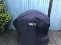 Amazing BBQ Weber Q3200 with permanent cart and premium cover
