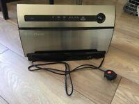 Foodsaver automated vacuum sealer system