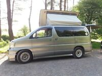 Nissan Elgrand campervan for sale. Petrol/LPG. Elevating roof