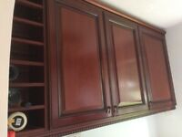 Mahogany kitchen units, solid wood doors, wall& base units, D. oven housing, larder cupboard.