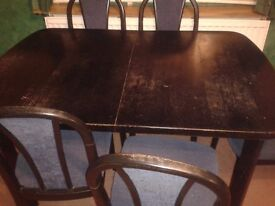 Extending table & 8 chairs, black wood with blue upholstry