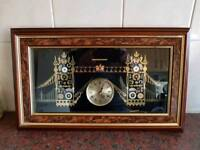 Clock in wooden frame