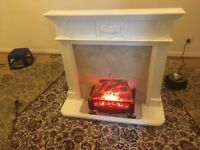 Free standing fire surround with built in electric fire.