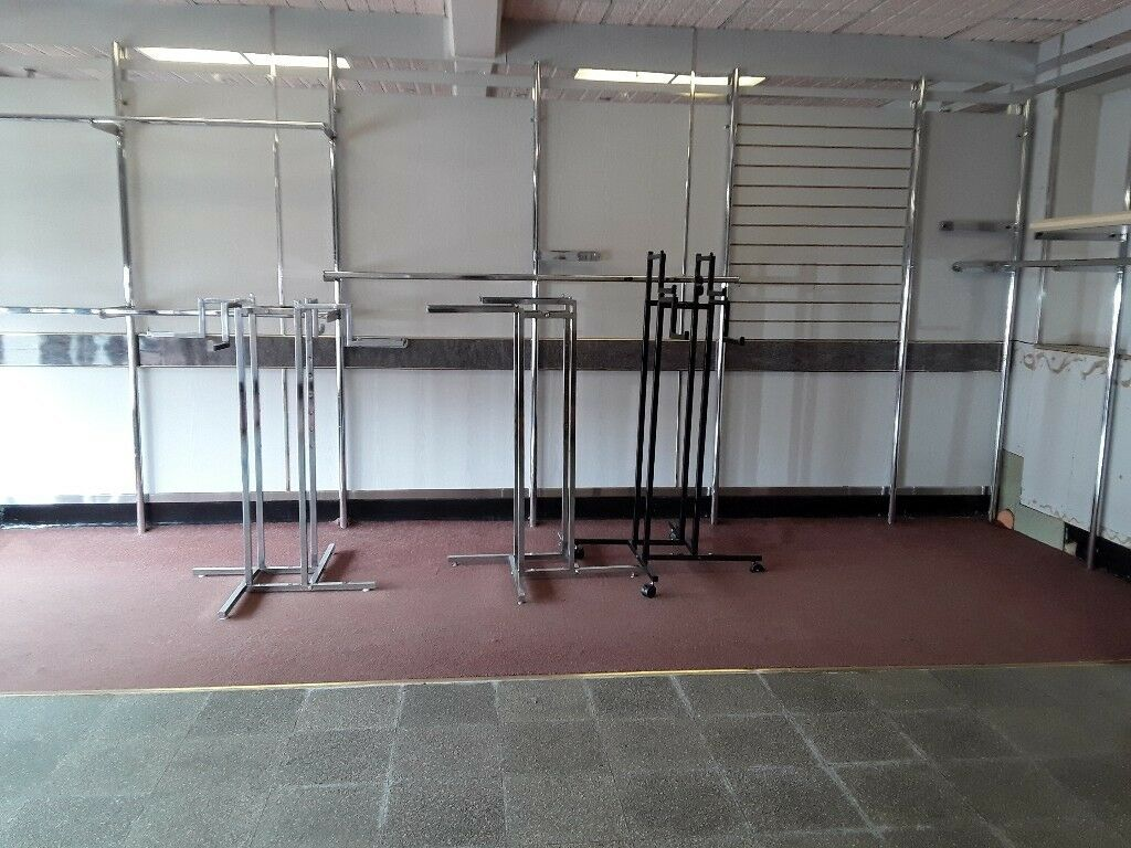 Shop fitting rails and free standing merchandising rails