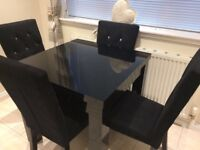 Next high gloss black table and chairs