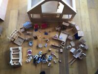 Wooden dolls house with loads of accessories