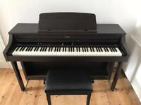 Roland H207e Digital Piano. Rosewood. 88 key touch sensitive.