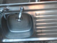 Kitchen sink, with taps and waste trap.