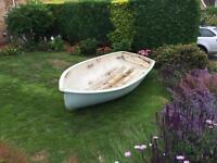 Boat: fibreglass dinghy with outboard motor