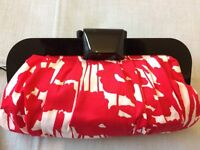 Coast Red and white patterned clutch handbag with polished black clasp