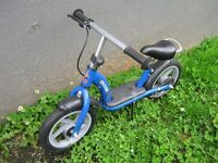 BALANCE BIKE IN GOOD USED CONDITION IT HAS A REAR BRAKE AND A STAND.The seat is height adjustable.