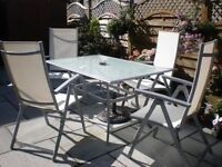 GARDEN TABLE AND 4 MATCHING CREAM CHAIRS