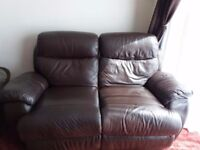 Brown leather two seater reclining sofa